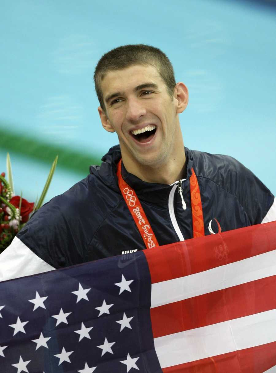 02) Michael - 3,298  (Pictured is Michael Phelps, multi-gold medal winner in three Summer Olympics)