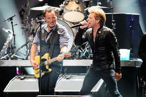 Bruce Springsteen, left, and Jon Bon Jovi perform at the 12-12-12 The Concert for Sandy Relief at Madison Square Garden in New York