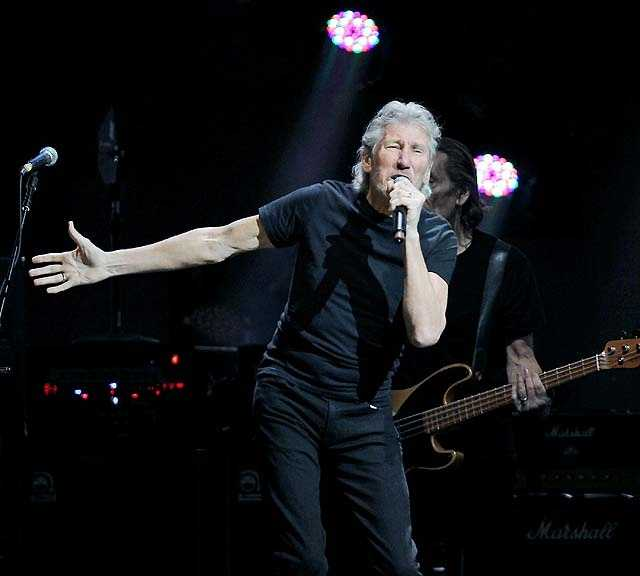 """Roger Waters performing. Waters, who has lived in New York for 11 years, said """"there's a great feeling of camaraderie"""" backstage and that he's excited he could help those who are suffering."""