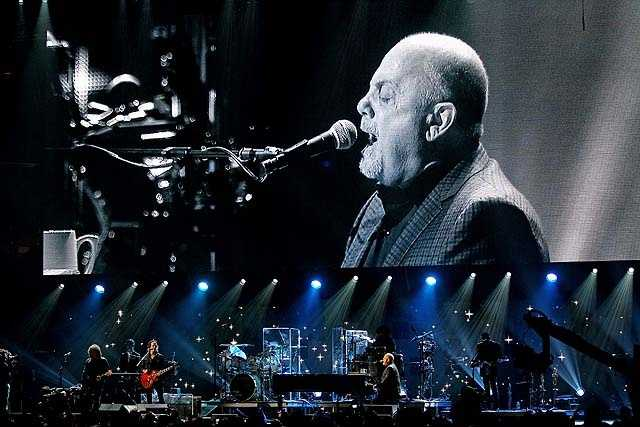 """Billy Joel performed one of the last century's favorites, """"New York State of Mind."""" Joel's """"Miami 2017 (Seen the Lights Go Out on Broadway)"""" sounded prescient, with new Sandy-fueled lyrics smoothly fitting in. He was also the only artist to mark the season, working in a little of """"Have Yourself a Merry Little Christmas."""""""