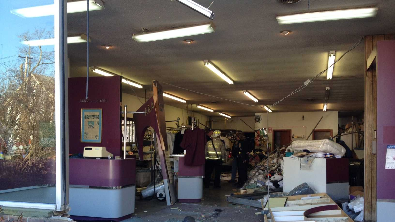 Manchester Car Into  Drycleaners