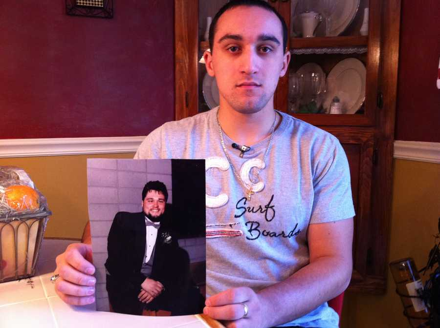 Bryan Fleury with a picture of his father, Wayne Fleury, who died at age 48.