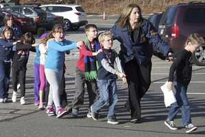 "As teachers rushed students out of the school, the children were told to ""not look,"" so they would not see what had happened at Sandy Hook Elementary School."