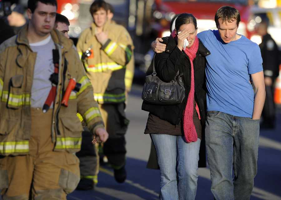 A victim's family leaves a firehouse staging area following a shooting at the Sandy Hook Elementary School.