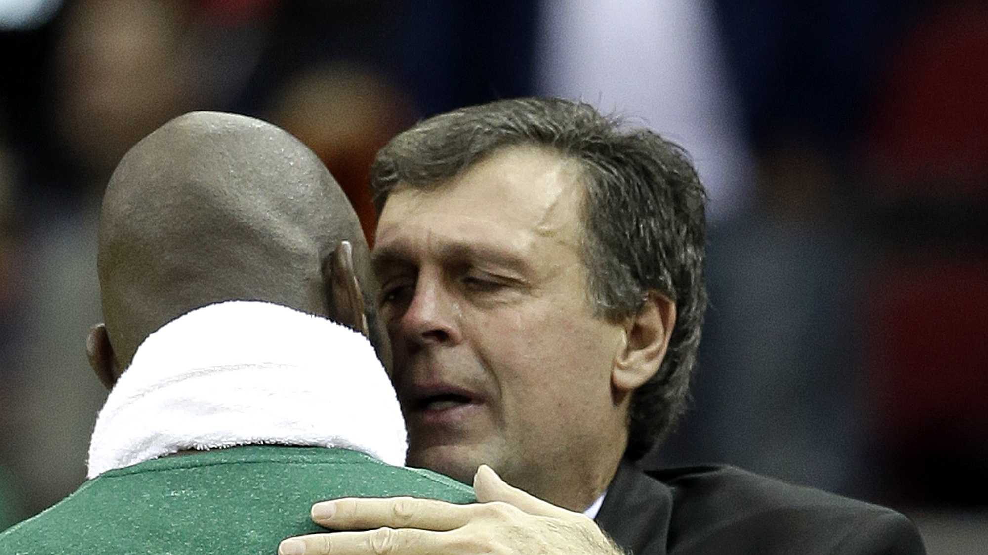 Houston Rockets coach Kevin McHale, right, is hugged by Boston Celtics' Kevin Garnett.
