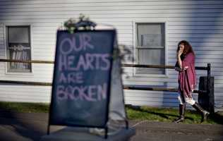 Shop owner Tamara Doherty paces outside her store just down the road from Sandy Hook Elementary School.