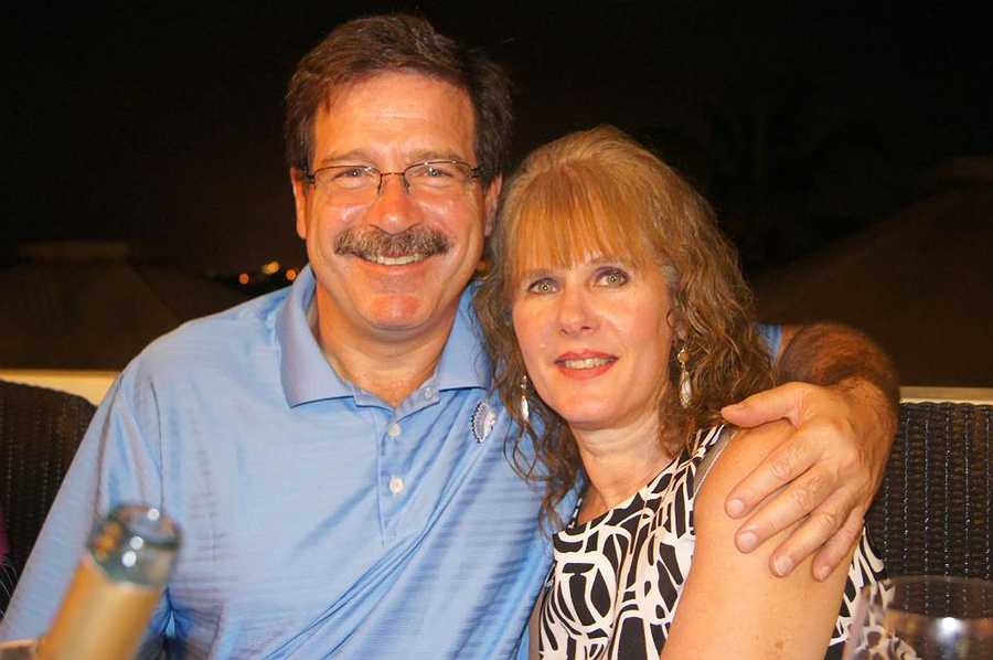 In this undated photo provided by Mark Sherlach, Mark Sherlach and his wife, school psychologist Mary Sherlach, pose for a photo. Mary Sherlach was killed Friday, Dec. 14, 2012, when a gunman opened fire at Sandy Hook Elementary School.
