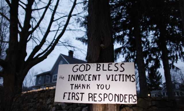 A message of thanks and prayer is displayed outside a home in the wake of a deadly school shooting, Sunday, Dec. 16, 2012, in Newtown, Conn.