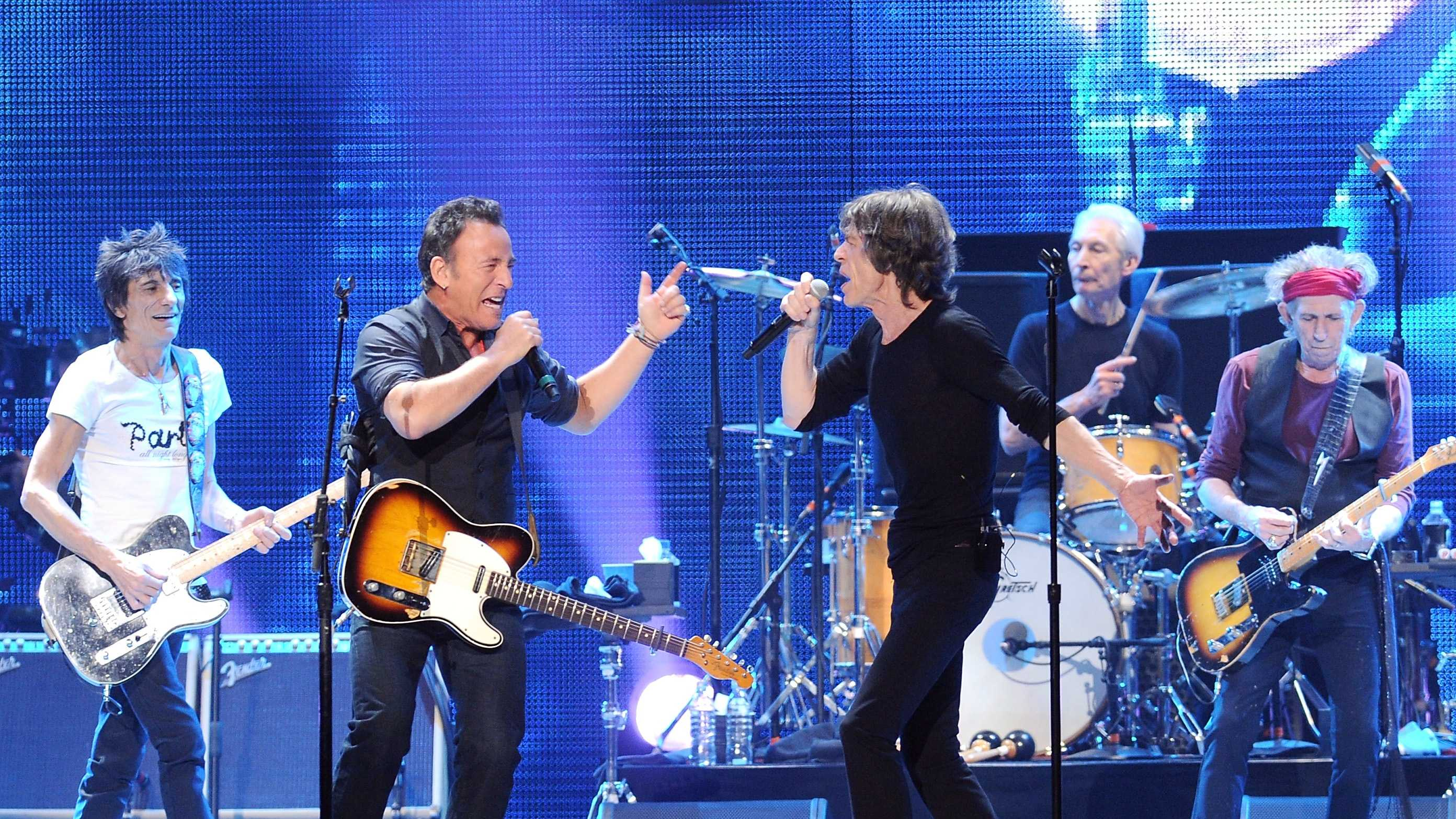 Bruce Springsteen, center left, performs with, from left, Ronnie Wood, Mick Jagger, Charlie Watts and Keith Richards of The Rolling Stones at the Prudential Center in Newark, NJ on Saturday, Dec. 15, 2012.