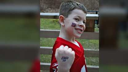 "Six-year-old Jack Pinto was a member of the Newtown Youth Wrestling Association and a huge fan of the New York Giants, especially wide receiver Victor Cruz. On Sunday, December 16, 2012, Cruz wrote Jack's name on his cleats alongside ""My Hero,"" and also on his gloves, next to a message saying he was playing the game for Jack."