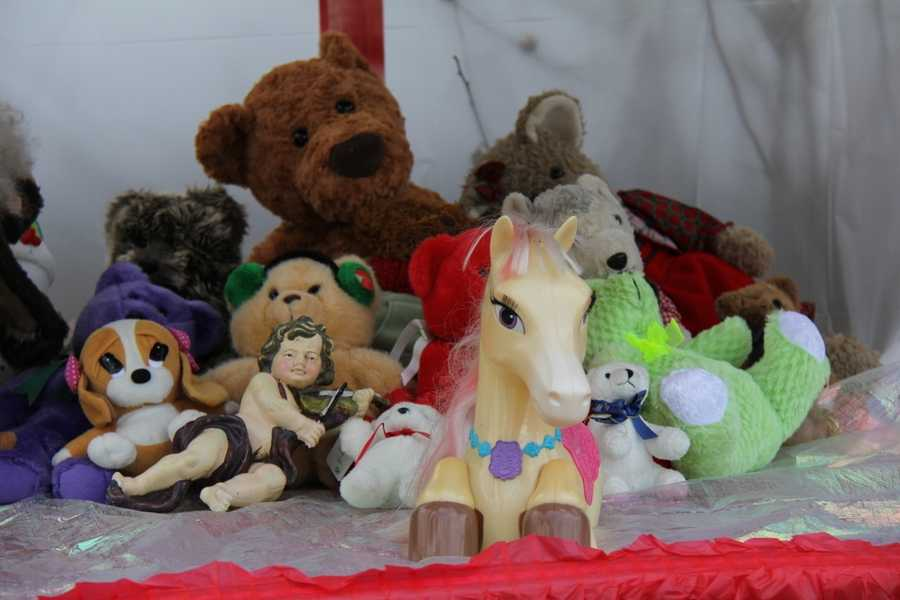 A variety of teddy bears and toys were placed out front under the photos of the victims.