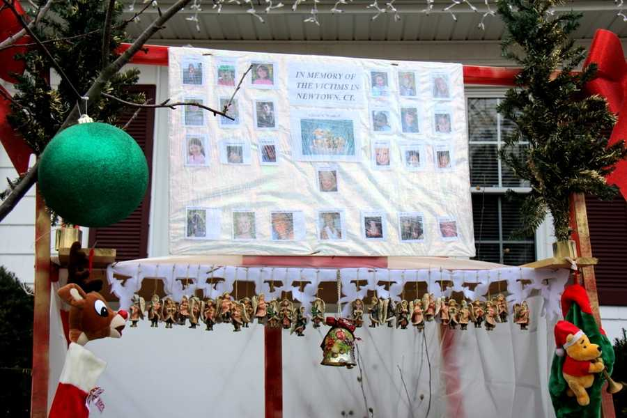 He searched for photos of each one of the victims... putting together this display on the front lawn of the home.