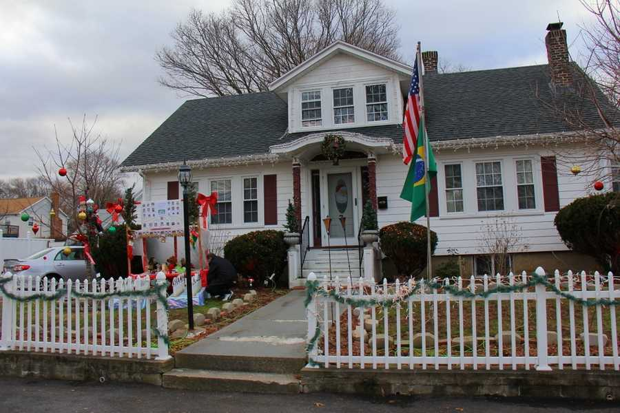 Christmas lights are on display all across the Commonwealth, but the man who lives in this Dedham home felt tremendous sadness after watching news reports of the school shooting in Newtown, Conn.