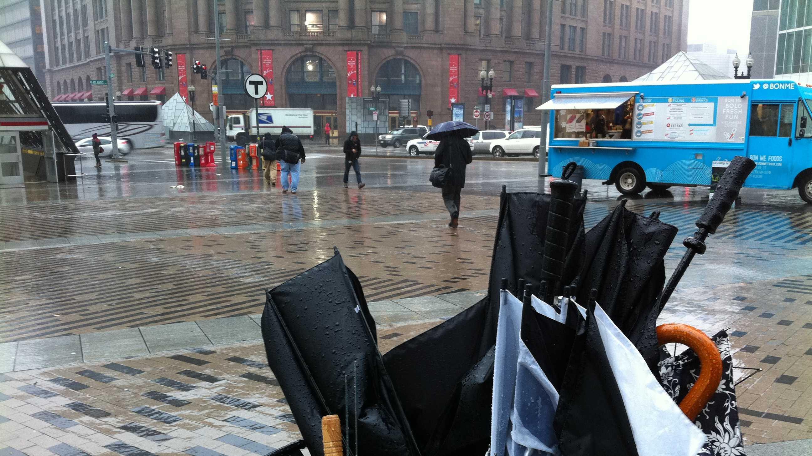 broken umbrellas in trash