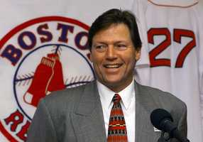 Carlton Fisk, reacts during a news conference at Fenway Park, Jan. 14, 2000 where the Boston Red Sox announced they will retire his number 27, then only the fifth number in team history to be retired. Fisk was inducted into baseball's Hall of Fame in Cooperstown, N.Y. on July 23, 2000.
