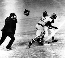 Boston catcher Carlton Fisk claimed interference when he fielded Ed Armbristers bunt then collided with him before throwing to second in an attempt to nail Cesar Geronimo, Oct. 15, 1975. The throw sailed over the head of second baseman Denny Doyle, setting up the winning run for Cincinnati and giving them a 2-1 lead in the World Series. The umpire is unidentified.