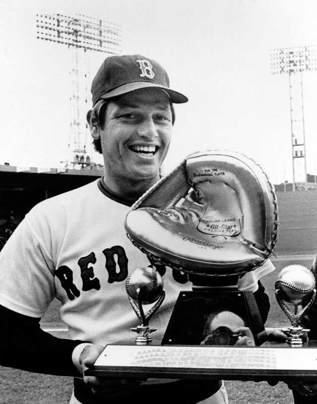 Boston Red Sox catcher Carlton Fisk holds the Ford C. Frick Award as the 1972 American League Rookie of the year and his Red Glove Award presented before the Red Sox-New York Yankees game, on April 9, 1973 at Boston. He was the first player to be unanimously voted American League Rookie of the Year.