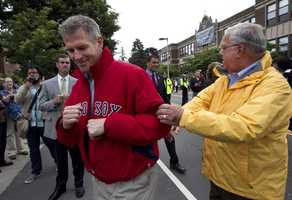 U.S. Sen. Scott Brown, R-Mass., left, shares a light moment with Boston Mayor Thomas Menino, right, before the start of the annual Dorchester Day Parade, June 3, 2012.