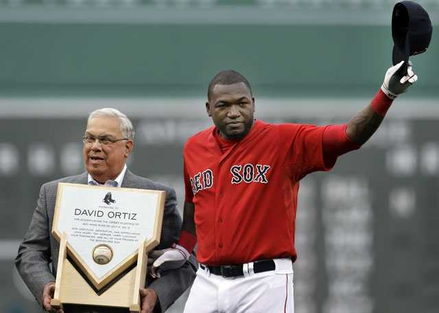 Boston Red Sox designated hitter David Ortiz tips his cap to the fans as Boston Mayor Thomas Menino presents him with a plaque during a ceremony in honor of Ortiz's 400th career home run, prior to the Red Sox's baseball game against the New York Yankees at Fenway Park, July 6, 2012.