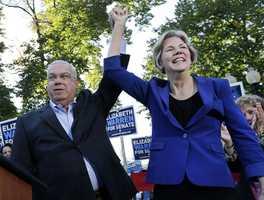 Boston Mayor Thomas Menino holds up the hand of Democratic U.S. Senate candidate Elizabeth Warren at a campaign rally in Boston's Roslindale neighborhood, Sept. 21, 2012 where Menino endorsed her candidacy against incumbent U.S. Sen. Scott Brown.