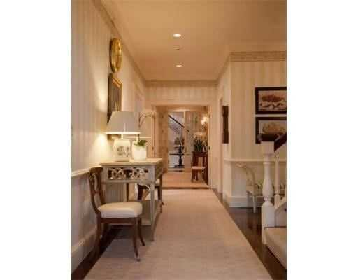 Formal & informal rooms overlook impeccable grounds.