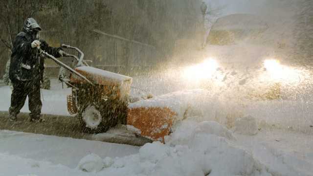 Snow man with snowblower at night.jpg