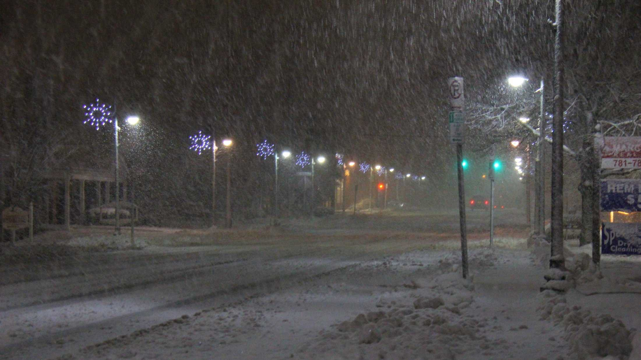 Heavy snow falling Saturday night along Route 27 in Sharon.