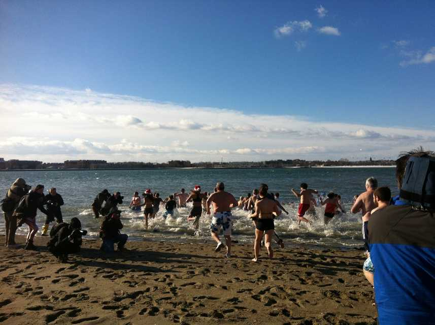 Every year, people brave cold temperatures for a quick dip into the waters at Carson Beach in South Boston