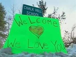 Classes resume for Sandy Hook Elementary School students for the first time since a gunman killed 20 of their classmates.