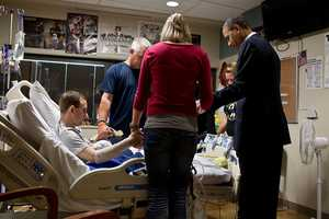 June 28, 2012 The President prays with a wounded service member and his family during a visit to Walter Reed National Military Medical Center in Bethesda, Md. The President likes to make a few trips a year to Walter Reed to visit wounded warriors and their families.