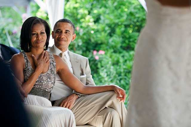 June 18, 2012 The First Lady reacts as she watches Laura Jarrett and Tony Balkissoon take their vows during their wedding at Valerie Jarrett's home in Chicago.