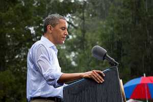 July 14, 2012 - The President delivers remarks in the pouring rain at a campaign event in Glen Allen, Va. He was supposed to do a series of press interviews inside before his speech, but since people had been waiting for hours in the rain he did his remarks as soon as he arrived at the site so people could go home to dry off .