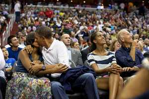 July 16, 2012 The President and First Lady were attending the game between the U.S. Men's Olympic basketball team and Brazil in Washington, D.C. During the first half, the jumbotron flashed couples on their 'Kiss Cam', where they are then induced by the crowd to kiss each other.