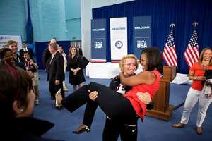 July 27, 2012 Sonya Hebert captured this amusing moment as U.S. Olympic wrestler Elena Pirozhkova literally picked up the First Lady during a greet with Team USA Olympic athletes competing in the 2012 Summer Olympic Games in London.""