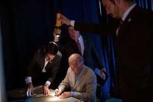 Sept. 2, 2012 - David Lienemann made this unusual photo as staff held flashlights so the Vice President could see as he signed autographs backstage at West York Area High School in York, Pa.""