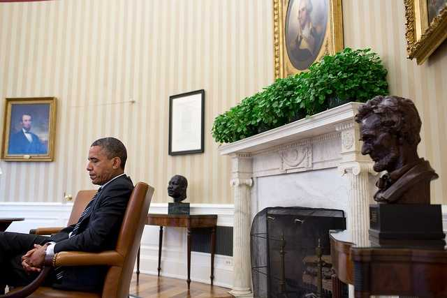 Sept. 28, 2012 - A candid portrait of the President during a meeting, juxtaposed with the paintings of Abraham Lincoln and George Washington, busts of Martin Luther King, Jr., and Abraham Lincoln, and the Emancipation Proclamation. It's a difficult angle to get because I had to sit in front of the closed Oval Office door and hope that no one would open the door and knock me over.