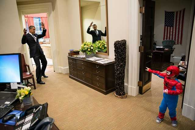 Oct. 26, 2012 The President pretends to be caught in Spider-Man's web as he greets the Nicholas Tamarin, 3, just outside the Oval Office. Spider-Man had been trick-or-treating for an early Halloween with his father, White House aide Nate Tamarin in the Eisenhower Executive Office Building. I can never commit to calling any picture my favorite, but the President told me that this was HIS favorite picture of the year when he saw it hanging in the West Wing a couple of weeks later.(