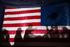 Nov. 3, 2012 - I had noticed the possibility of a potential good photograph if the President were to pass by this flag as he departed an evening campaign rally in Dubuque, Iowa. So I planted myself backstage as he finished working a ropeline and managed to get one usable frame as he walked by