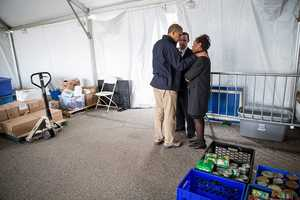 Nov. 15, 2012 The President tries to comfort Damien and Glenda Moore at a FEMA Disaster Recovery Center tent in Staten Island, N.Y. The Moore's two small children, Brandon and Connor, died after being swept away during Hurricane Sandy.
