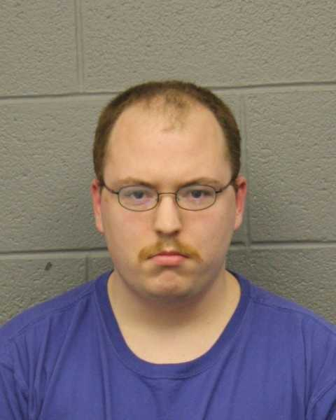 Daniel Grenon was arrested by Webster Police and charged with assault and battery with a dangerous weapon, 6 counts of improper storage of a firearm, and improper storage of ammunition.