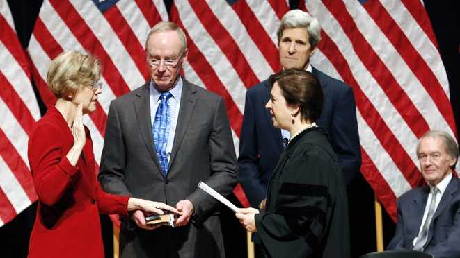 Supreme Court Justice Elena Kagan, foreground right, administers the oath of office to Sen. Elizabeth Warren, D-Mass., left, as Warren's husband Bruce Mann, center, holds a bible and Sen. John Kerry, D-Mass., rear second from right, and U.S. Rep. Edward Markey, D-Mass., right, watch during a re-enactment of Warren's Senate swearing-in ceremony at Roxbury Community College in Boston, Saturday, Jan. 5, 2013.
