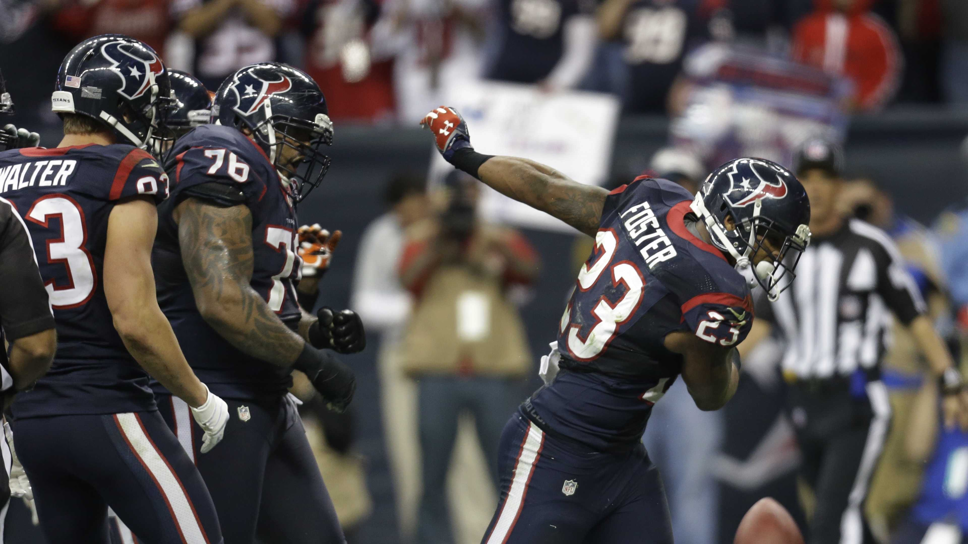 Houston Texans running back Arian Foster (23) celebrates his one-yard touchdown run against the Cincinnati Bengals.
