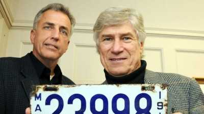 Mark Cuddy, executive vice president of Richardson-Cuddy Insurance, with Ted Leach, who holds a license plate from 1912.