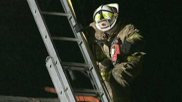 Rookie firefighter helps save woman