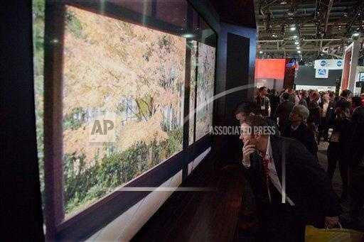 Industry affiliates examine Sharp 85-inch 8K large screen television.