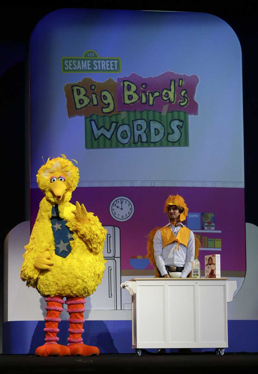 Sesame Street character Big Bird and Birdkateer Dave demonstrate an educational reading tool for children.