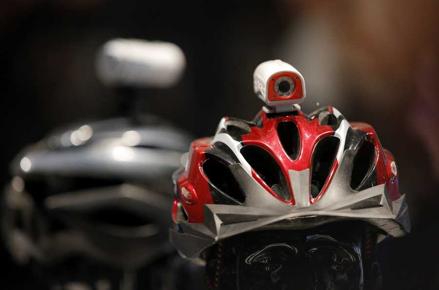 Polaroid's HD sports video camera is mounted on a helmet.
