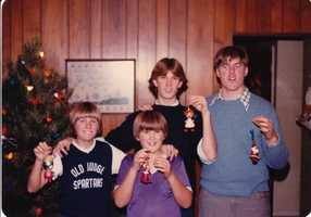 David, seen here with siblings in a childhood holiday picture, says his first job was as a janitor at his church.