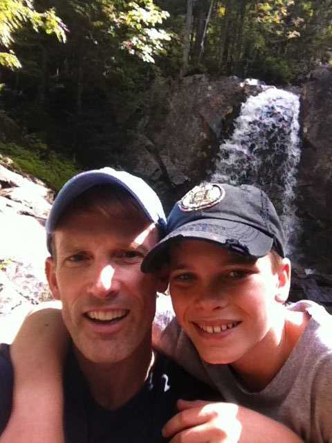 David, pictured here on a hike with his son, says his high school principal Al Burr had the greatest influence in his life.