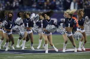 New England Patriots' cheerleaders perform during before an AFC divisional playoff NFL football game between the New England Patriots and the Houston Texans.